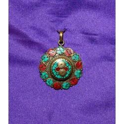 Bronze pendant from Nepal .